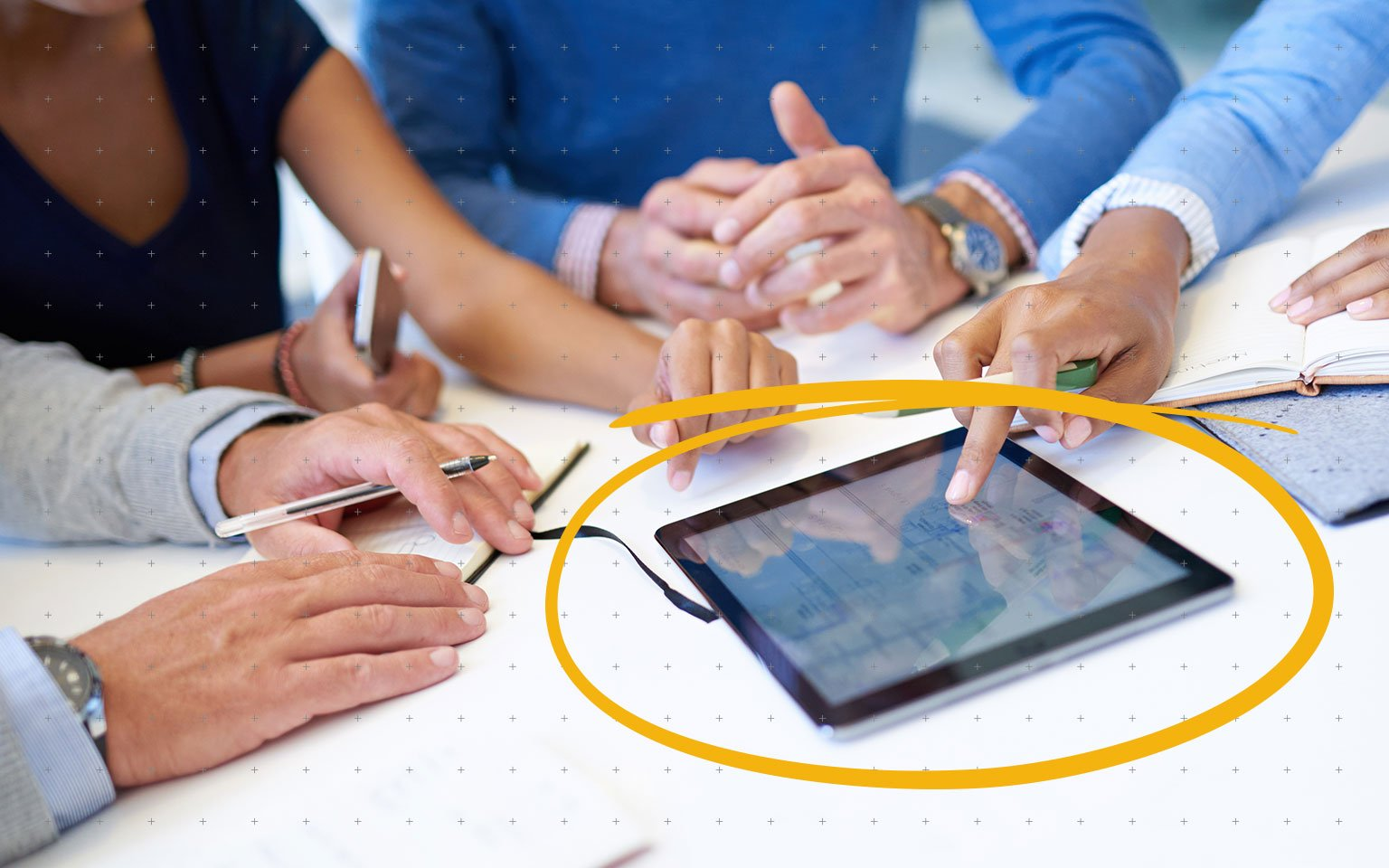 close up of colleagues using a tablet in a meeting
